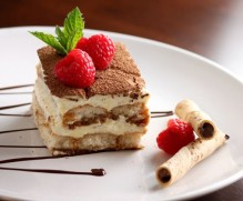Traditional Italian Dessert Tiramisu  with savory mascarpone cheese and fresh coffee, layered with lady finger biscuits